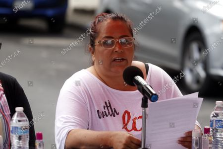 The mother of Yesenia Quiroz Alfaro, Indira Alfaro during a protest to demand justice for  Murdered  victims, activist Nadia Vera, domestic worker Alejandra Negrete, beauty student Yesenia Quiroz, model Mile Martin and photojournalist Ruben Espinosa, that they were killed with firearm shots,  inside of  department of the 1909 building, on Luz Savinon street in  Narvarte neighborhood 6 years ago.