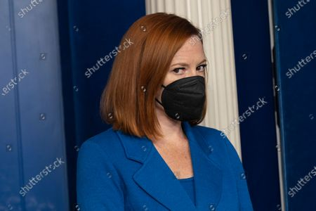 White House Press Secretary Jen Psaki listens during a briefing with White House American Rescue Plan Coordinator and Senior Advisor to the President Gene Sperling at the White House in Washington, DC,