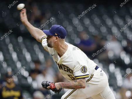 Stock Photo of Milwaukee Brewers' John Axford pitches against the Pittsburgh Pirates during the ninth inning of a baseball game, in Milwaukee