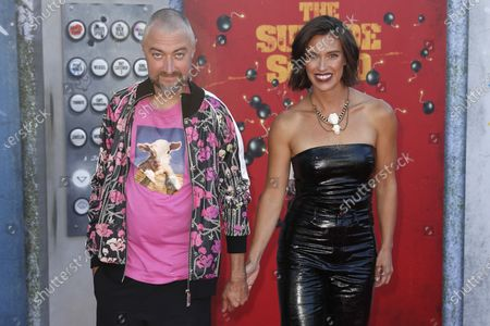 Sean Gunn (L) and his wife US actress Natasha Halevi (R) pose on the red carpet prior to the world premiere of DC Film's 'The Suicide Squad' at the Regency Village Theatre in Los Angeles, California, USA, 02 August 2021. The movie will be released in US theaters on 06 August 2021.