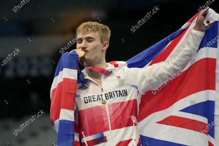 Jack Laugher of Britain pose for a photo after winning bronze medal in men's diving 3m springboard final at the Tokyo Aquatics Centre at the 2020 Summer Olympics, in Tokyo, Japan