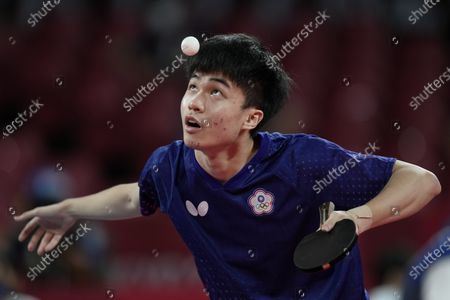 Taiwan Lin Yun-ju compete during the table tennis men's team quarterfinal against Germany's Dimitrij Ovtcharov at the 2020 Summer Olympics, in Tokyo, Japan