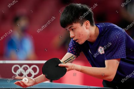 Stock Photo of Taiwan Lin Yun-ju compete during the table tennis men's team quarterfinal against Germany's Dimitrij Ovtcharov at the 2020 Summer Olympics, in Tokyo, Japan