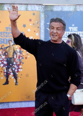 """Sylvester Stallone, a cast member in """"The Suicide Squad,"""" poses with girlfriend Kelly Gale at the premiere of the film at the Regency Village Theatre, in Los Angeles"""