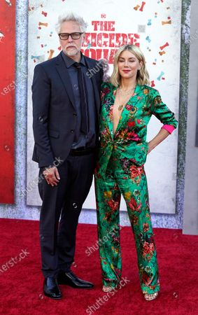 """James Gunn, writer/director of """"The Suicide Squad,"""" poses with his girlfriend Jennifer Holland at the premiere of the film at the Regency Village Theatre, in Los Angeles"""
