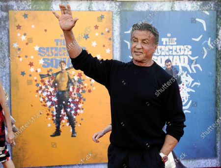 """Sylvester Stallone, a cast member in """"The Suicde Squad,"""" waves at the premiere of the film at the Regency Village Theatre, in Los Angeles"""