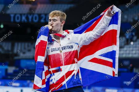 Jack Laugher of Great Britain poses with his Bronze medal and a British flag after finishing third in the Men's 3m Springboard Diving Final during the Diving events of the Tokyo 2020 Olympic Games at the Tokyo Aquatics Centre in Tokyo, Japan, 03 August 2021.