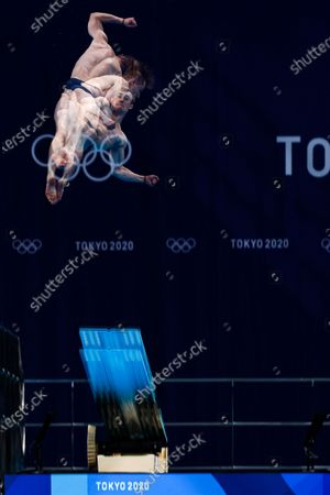 A multiple exposure photograph shows Jack Laugher of Great Britain performing in the Men's 3m Springboard Diving Semifinal during the Diving events of the Tokyo 2020 Olympic Games at the Tokyo Aquatics Centre in Tokyo, Japan, 03 August 2021.