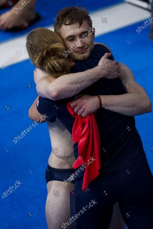 Jack Laugher of Great Britain hugs coach Jen Leeming after finishing third in the Men's 3m Springboard Diving Final during the Diving events of the Tokyo 2020 Olympic Games at the Tokyo Aquatics Centre in Tokyo, Japan, 03 August 2021.