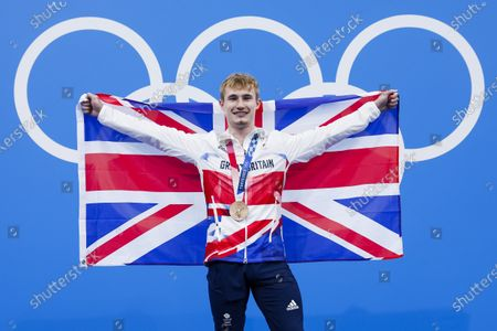 Jack Laugher of Great Britain poses with his Bronze medal and a British flag after finishing third in the MenÕs 3m Springboard Diving Final during the Diving events of the Tokyo 2020 Olympic Games at the Tokyo Aquatics Centre in Tokyo, Japan, 3 August 2021.