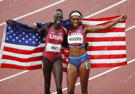 Athing Mu of the USA and Raevyn Rogers of the USA celebrate after winning the gold and bronze medal in the Women's 800 M final at the Tokyo 2020 Summer Olympic Games in Tokyo, Japan on Tuesday, August 3, 2021.