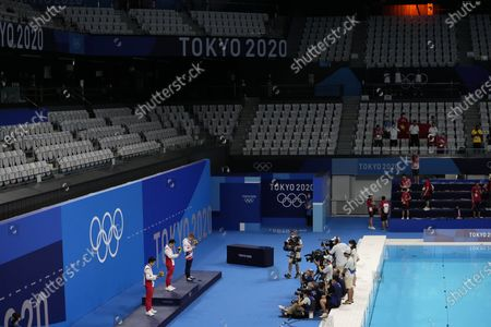From left second placed Wang Zongyuan of China, first placed Xie Siyi of China and third placed Jack Laugher of Britain stand on the podium of a men's diving 3-meter springboard final at the 2020 Summer Olympics, in Tokyo, Japan