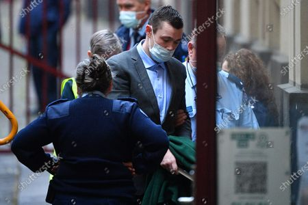 Mark Dixon (C) arrives to the Supreme Court of Victoria in Melbourne, Victoria, Australia, 03 August 2021. Jury deliberations for Mark Dixon, Jack Harvey and Stephen Tahaney who are charged with the attempted murder of former New South Wales (NSW) police detective Sid Morgan.