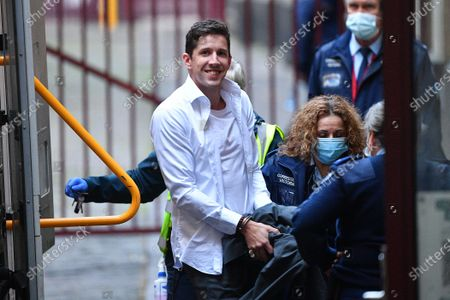 Jack Harvey (L) arrives to the Supreme Court of Victoria in Melbourne, Victoria, Australia, 03 August 2021. Jury deliberations for Mark Dixon, Jack Harvey and Stephen Tahaney who are charged with the attempted murder of former New South Wales (NSW) police detective Sid Morgan.