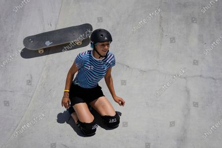 Lizzie Armanto of Finland takes a fall during a women's park skateboarding practice session at the 2020 Summer Olympics, in Tokyo, Japan