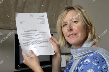 Suzanne Lloyd with the letter from her local Primary Care Trust turning her down for treatment
