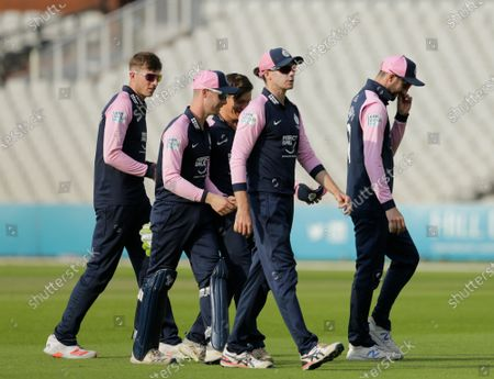 Stock Photo of Middlesex captain Peter Handscomb leads his team off after they took the final Lancashire wicket and won by six runs in the final over; Emirates Old Trafford, Manchester, Lancashire, England; Royal London Cup Cricket, Lancashire versus Middlesex.