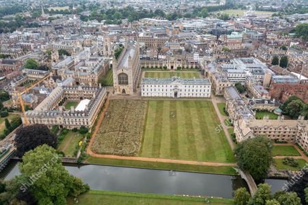 """Picture dated July 31st shows the wildflower meadow at King's College Cambridge that has now been harvested by shire horses on Monday. The magnificent wildflower meadow at King's College in Cambridge has been traditionally harvested today (Mon) - with the help of two Shire horses.It looked like a scene from a John Constable painting this morning as the two heavy horses helped cut the new meadow, which recently replaced the college's famous neatly-manicured lawn.The horses will turn and cart the hay on a traditional wain later in the week, with the bales being used to create more wildflower meadows across the city of Cambridge.This traditional method of harvesting gives the animals within the meadow time to leave the area, whilst the mowing is an important long-term process to keep fertility low and create space for the wildflowers to regenerate.The involvement of the Shire horses is thanks to an initiative involving the head gardeners of Christ's College and Murray Edwards College. The resultant bales will be offered to other gardeners around the city and within Cambridge University, encouraging others to follow suit and similarly turn their lawns into wildflower meadows.Steven Coghill, head gardener of King's College, said: """"We're absolutely thrilled to be bringing in these magnificent heavy horses to harvest the wildflower meadow. """"Not only do they have a far lower carbon footprint than using a rotary mower, the sight of these wonderful creatures at work in the College should make for a remarkable, bucolic scene and bring a bit of Constable to Cambridge.""""Professor Michael Proctor, Provost of King's College, added: """"The wildflower meadow has inspired us to think more about how we look after and enhance our biodiversity, and has brought to attention just how much has been lost. """"We hope its presence in this iconic setting will motivate others to think about sustainability and to consider planting their own meadows elsewhere."""