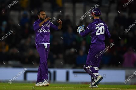 Adil Rashid and John Simpson of Northern Superchargers celebrate the wicket of James Vince during the The Hundred match between Southern Brave and Northern Superchargers at The Ageas Bowl, Southampton