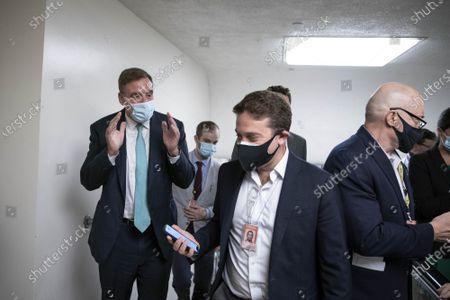 Senator Mark Warner (D-VA) talks to reporters while walking through the Senate subway at the U.S. Capitol in Washington DC, on Tuesday, August 3, 2021. Senators are voting on amendments to the Infrastructure Investment and Jobs Act.