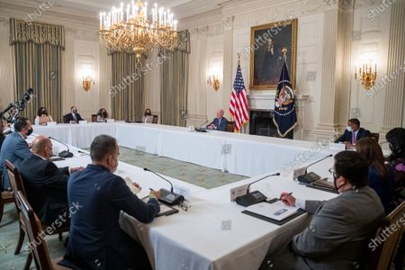Stock Picture of US President Joe Biden, with Vice President Kamala Harris, meets with Latino community leaders to discuss his economic agenda, immigration reform and the need to protect the right to vote in the State Dining Room of the White House in Washington, DC, USA, 03.