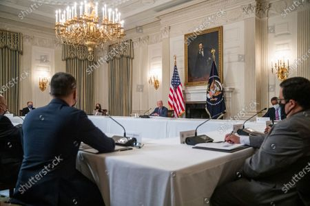 Stock Photo of US President Joe Biden, with Vice President Kamala Harris, meets with Latino community leaders to discuss his economic agenda, immigration reform and the need to protect the right to vote in the State Dining Room of the White House in Washington, DC, USA, 03.