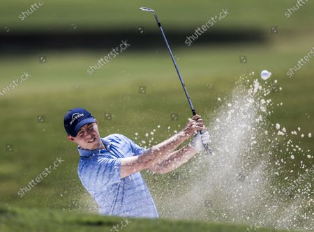 Matt Fitzpatrick of England hits form a sand trap by the chipping green during practice for the World Golf Championships FedEx-St. Jude Invitational golf tournament at TPC Southwind in Memphis, Tennessee, USA, 03 August 2021.