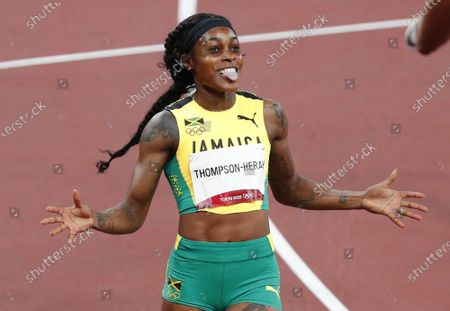 Elaine Thompson-Herah of Jamaica celebrates after winning the gold medal in the Women's 200 M final at the Tokyo 2020 Summer Olympic Games in Tokyo, Japan on Tuesday, August 3, 2021.