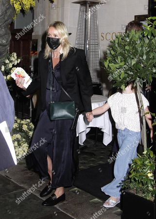 Stock Photo of Julia Carey and Carey Corden are seen leaving Scott'ss