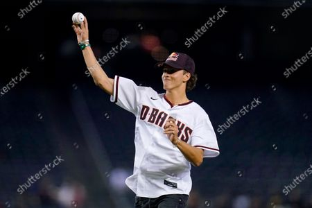 Jagger Eaton, of Mesa, Ariz., the Olympic bronze medalist in men's street competition in skateboarding at the 2020 Tokyo Olympics, throws out the first pitch prior to a baseball game between Arizona Diamondbacks and the San Francisco Giants, in Phoenix