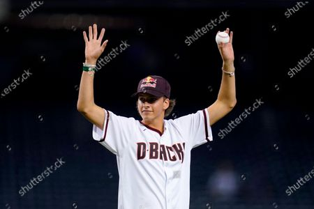 Jagger Eaton, the United States Olympic bronze medalist for men's street competition in skateboarding in the 2021 Tokyo Olympics, waves to cheering fans prior to throwing out the first pitch in a baseball game between Arizona Diamondbacks and the San Francisco Giants, in Phoenix