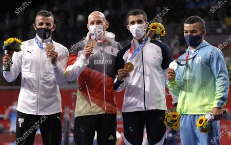 L-R: Bronze medalist Mohamed Ibrahim Elsayed of Egypt, bronze medalist Frank Staebler of Germany, gold medalist Mohammedreza Geraei of Iran and silver medalist Parviz Nasibov of Ukraine pose on the podium for Men's Greco-Roman 67kg category at the Wrestling events of the Tokyo 2020 Olympic Games at the Makuhari Messe convention centre in Chiba, Japan, 04 August 2021.