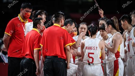 Stock Photo of (210804) - SAITAMA, Aug 4, 2021 (Xinhua) - Yao Ming (1st L) is seen during the women's basketball quarterfinal match between China and Serbia at the Tokyo 2020 Olympic Games in Saitama, Japan, Aug 4, 2021.