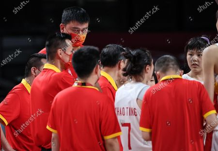 Stock Picture of (210804) - SAITAMA, Aug 4, 2021 (Xinhua) - Yao Ming (top) is seen during the women's basketball quarterfinal match between China and Serbia at the Tokyo 2020 Olympic Games in Saitama, Japan, Aug 4, 2021.