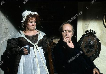 Ann Beach as Mrs. Sowerberry and Philip Locke as Sowerberry