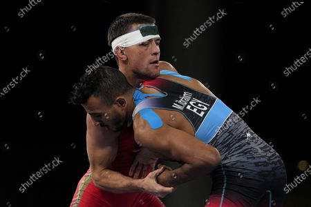Russian Olympic Committee's Artem Surkov, left, and Mohamed Ibrahim Elsayed of Egypt compete during the men's 67kg Greco-Roman wrestling bronze medal match at the 2020 Summer Olympics, in Chiba, Japan