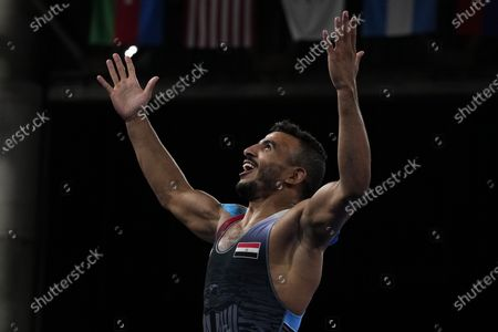 Mohamed Ibrahim Elsayed of Egypt celebrates defeating Russian Olympic Committee's Artem Surkov during the men's 67kg Greco-Roman wrestling bronze medal match at the 2020 Summer Olympics, in Chiba, Japan