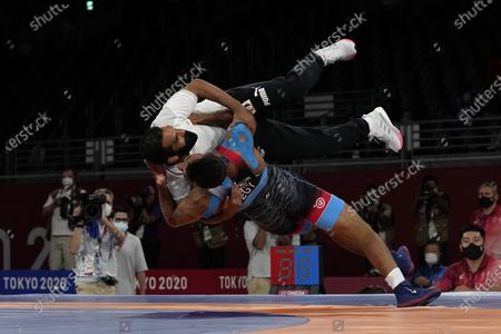 Mohamed Ibrahim Elsayed of Egypt celebrates with his coach defeating Russian Olympic Committee's Artem Surkov during the men's 67kg Greco-Roman wrestling bronze medal match at the 2020 Summer Olympics, in Chiba, Japan