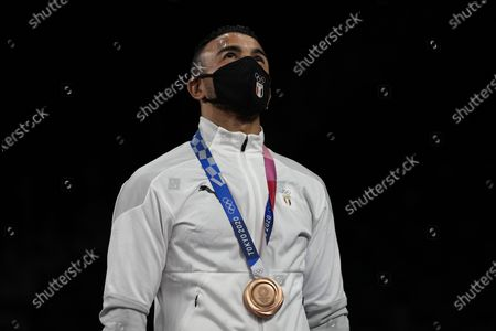 Bronze medalist, Mohamed Ibrahim Elsayed of Egypt celebrates on the podium during the medal ceremony for the men's 67kg Greco-Roman wrestling at the 2020 Summer Olympics, in Chiba, Japan