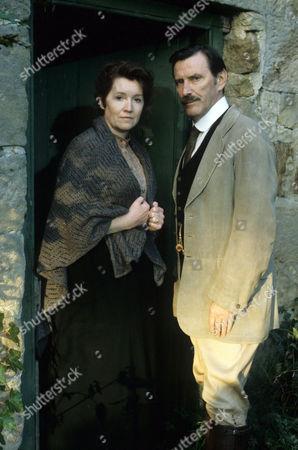 Madelaine Newton as Polly Benton and Tom Bell as Edward MacFell