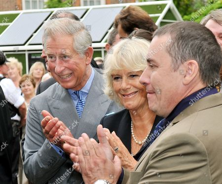 Prince Charles and The Camilla Duchess of Cornwall with Jools Holland (right) as they watch a cat organ