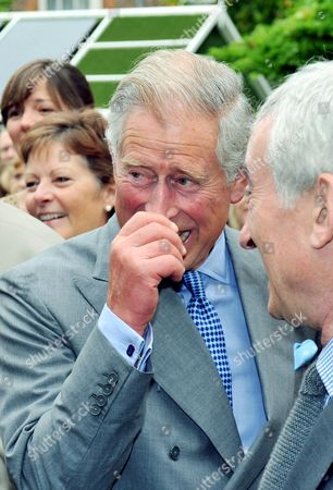 Prince Charles is caught in a fit of giggles as he watches a cat organ