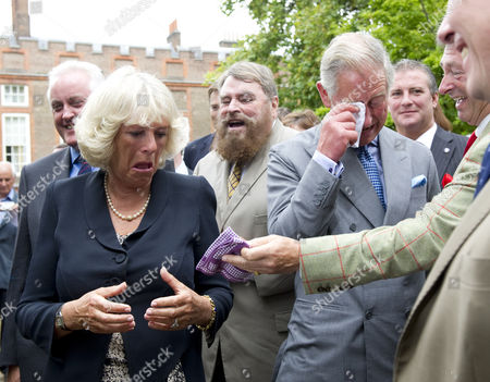 Prince Charles, Camilla Duchess of Cornwall and Brian Blessed are caught in a fit of giggles as they watch a cat organ, Alan Titchmarsh handing a handkerchief to Camilla