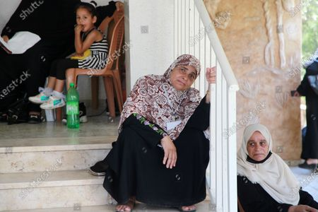 Families of Palestinian martyrs and wounded, take part in a protest against the Palestinian Authority's decision to cut their salaries for seven years, at house of the leader Yasser Arafat, in Gaza City on August 4, 2021. In January 2019, the PA cut the salaries of 2,700 families of martyrs and wounded people in Gaza without justification. The families of the martyrs of the 2014 war declared a hunger strike for the second time until their demands are met.