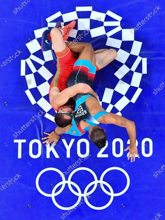 Stock Picture of (210804) - CHIBA, Aug 4, 2021 (Xinhua) - Mohamed Ibrahim Elsayed (R) of Egypt competes against Artem Surkov of ROC during the Wrestling Men's Greco-Roman 67kg Bronze Medal Match at Tokyo 2020 Olympic Games in Chiba, Japan on Aug 4, 2021.