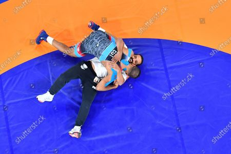 Stock Image of (210804) - CHIBA, Aug 4, 2021 (Xinhua) - Mohamed Ibrahim Elsayed (top) of Egypt celebrates with his coach after winning the Wrestling Men's Greco-Roman 67kg Bronze Medal Match against Artem Surkov of ROC at Tokyo 2020 Olympic Games in Chiba, Japan on Aug 4, 2021.