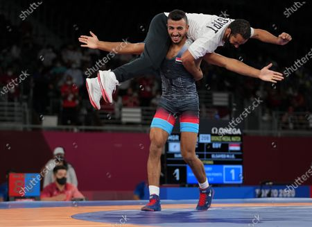 (210804) - CHIBA, Aug 4, 2021 (Xinhua) - Mohamed Ibrahim Elsayed Elsayed (bottom) of Egypt celebrates with his coach after the wrestling men's Greco-Roman 67kg bronze medal match between Artem Surkov of the Russian Olympic Committee (ROC) and Mohamed Ibrahim Elsayed Elsayed of Egypt at the Tokyo 2020 Olympic Games in Chiba, Japan, Aug 4, 2021.