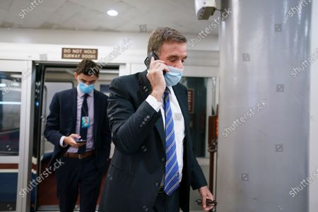 Stock Photo of Sen. Mark Warner, D-Va., arrives for votes on amendments to advance the $1 trillion bipartisan infrastructure bill, at the Capitol in Washington