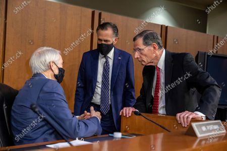 From left, Sen. Rob Portman, R-Ohio, Sen. Mitt Romney, R-Utah, and Sen. John Barrasso, R-Wyo., speak before a Senate Foreign Relations Committee meeting on Capitol Hill in Washington