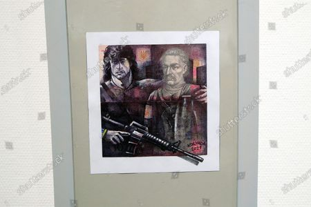 Stock Photo of Sylvester Stallone as Rambo painted next to Hetman Ivan Mazepa on a UAH10 banknote is pictured during the opening of the Hryvnia ART exhibition dedicated to the upcoming 30th Independence Day (August 24) and the development of contemporary Ukrainian art at the Museum of Kyiv History, Kyiv, capital of Ukraine.